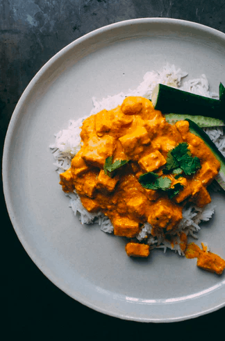 Cooked tofu served with rice
