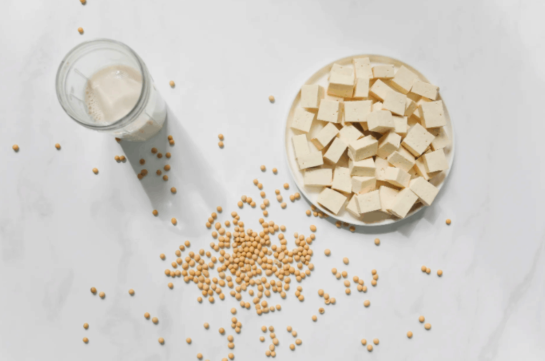 Tofu and soybeans on table