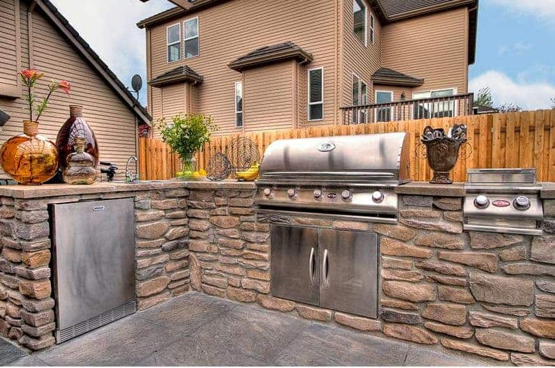 how far should a built in grill be from the house