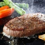 cooking steak on a griddle